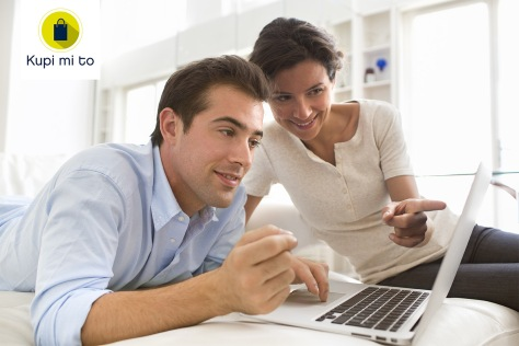 Couple using credit card to shop online